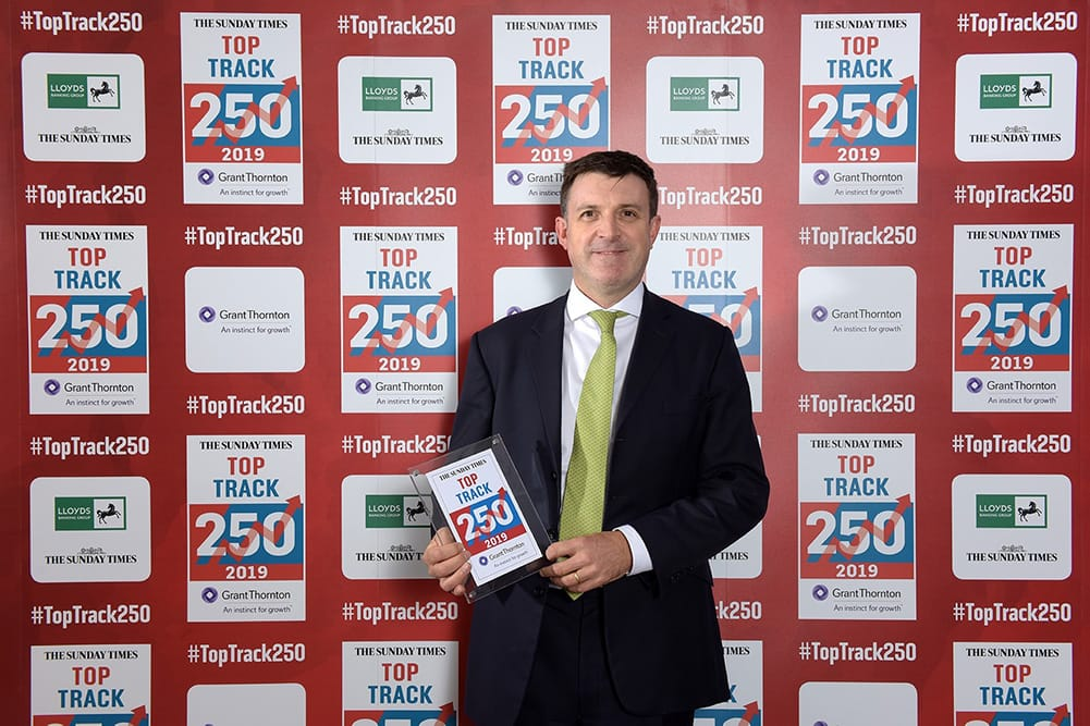 Mark Hudson receiving the Top Track 250 award